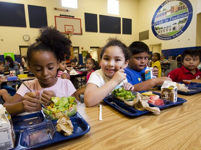 "The National Council of Farmer Cooperatives said Monday that new ""Buy American"" rules should apply to school lunches. USDA in 2012 showed off a new menu for students at an elementary school in Manassas, Va. (USDA photo)"