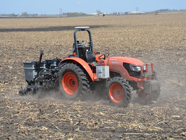 A driverless tractor and planter operated by Sabanto, a robotic farming company, seeds soybeans near Sac City, Iowa, last month. (DTN/Progressive Farmer photo by Matthew Wilde)