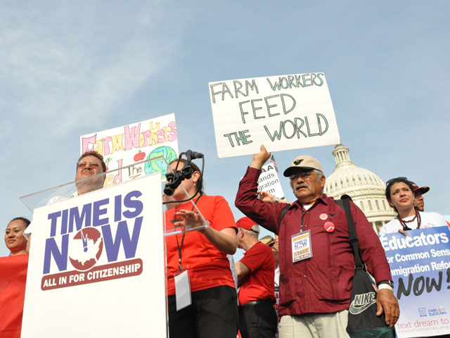 Farmworkers protest in 2013 during a rally calling on Congress to pass comprehensive immigration reform. The bill that passed the Senate had funding for 700 miles of a border barrier, but the bill never came up for a vote in the House. (DTN file photo)