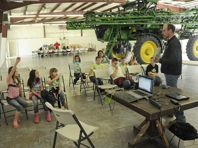 Third graders from Arlington Elementary learn about agricultural technology from Kelly Johnson with Platte Valley Equipment at the Ag Literacy Festival held at the Washington County Fairgrounds in Arlington, Neb., on May 2. (DTN photo by Russ Quinn)