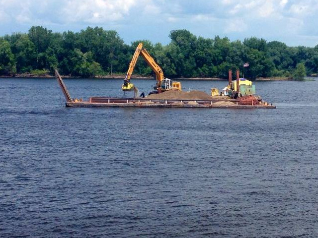 When shoaling occurs, the Army Corps of Engineers needs to dredge the area, closing all traffic on either side of the area. (Photo courtesy of USACE St. Paul District)