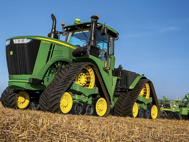 The new 9RX tractor marks John Deere's first entry into the four-track category and rounds out its 9 Series, which already had wheels and two tracks. (Photo courtesy John Deere)