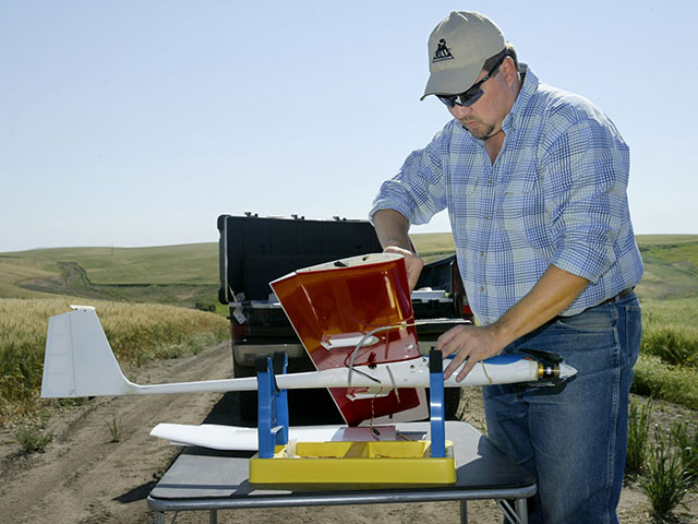 Wheat farmer and UAV expert Robert Blair sets up a plane for flight. He said fixed winged vehicles -- not hover craft -- will be the choice of professionals in the ag industry. (Photo courtesy Robert Blair)