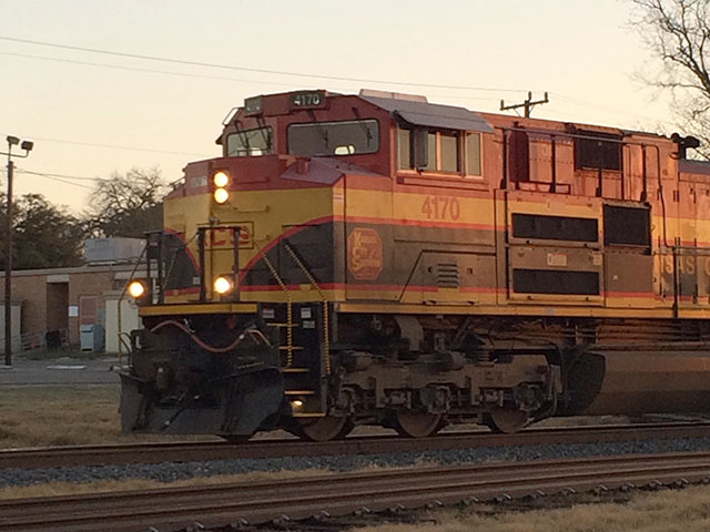 A Kansas City Southern train moves south in San Antonio, Texas, at dusk. (DTN photo by Mary Kennedy)