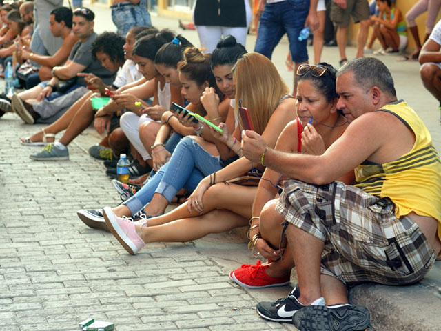 Cubans hang out on a Sunday afternoon at an internet hotspot in Old Havana. (Photo by Jim Patrico)