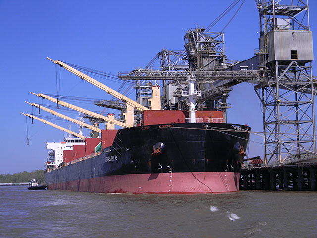 Ships like this one pictured loading upriver from the Gulf of Mexico will face restrictions as they head south to Baton Rouge due to flooding. This ship was loading soybeans at ADM at Destrehan, Louisiana, in late March. (DTN photo by Mary Kennedy)