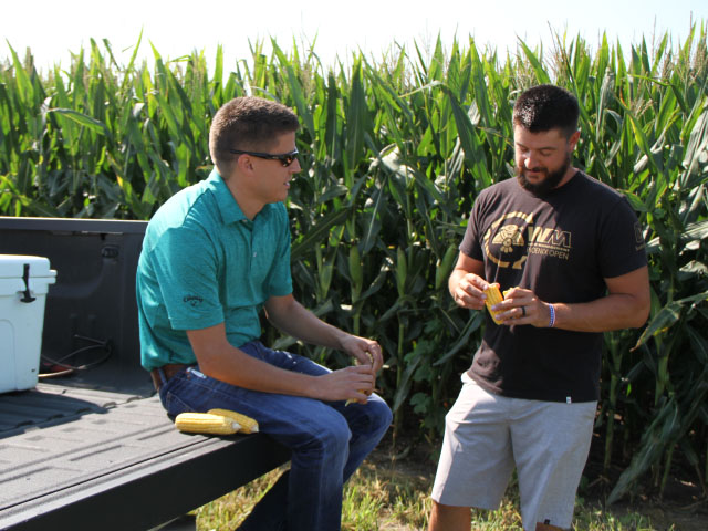 Assessing hybrids and varieties now helps plan for the coming season. Brian Wood, of Raymond, Illinois, depends on seed representative Dave Wallner to help him sort through the maze of new numbers. (DTN Photo by Pamela Smith)