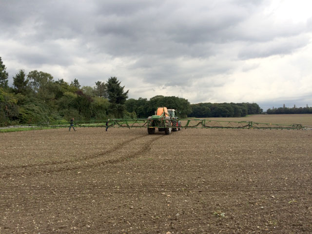 A crop sprayer lumbers across the landscape at Bayer's Laacher Hof concept farm near Monheim, Germany, to demonstrate how smart sprayers can target just areas where weeds escaped earlier treatments. (DTN photo by Pamela Smith)