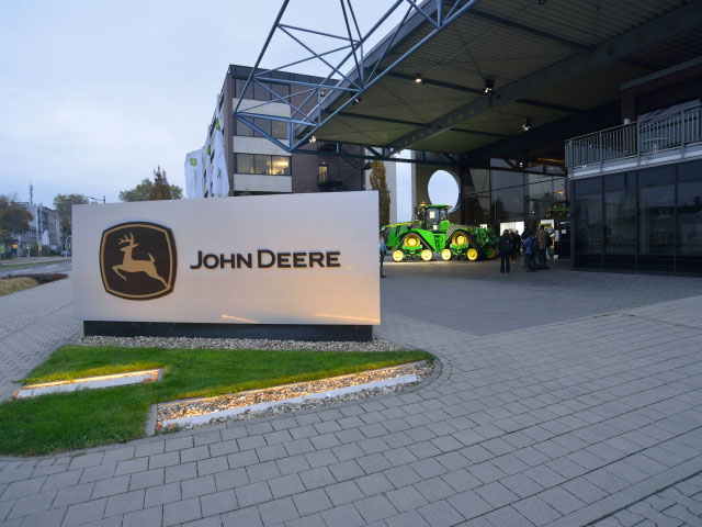 About 25,000 visitors annually stop at John Deere's tractor factory in Mannheim, Germany. The plant makes several versions of the 6 Series tractors, some of which are exported to North America. The 9RX in the background is for display only and came from the U.S. factory in Waterloo, Iowa. (DTN/The Progressive Farmer photo by Jim Patrico)