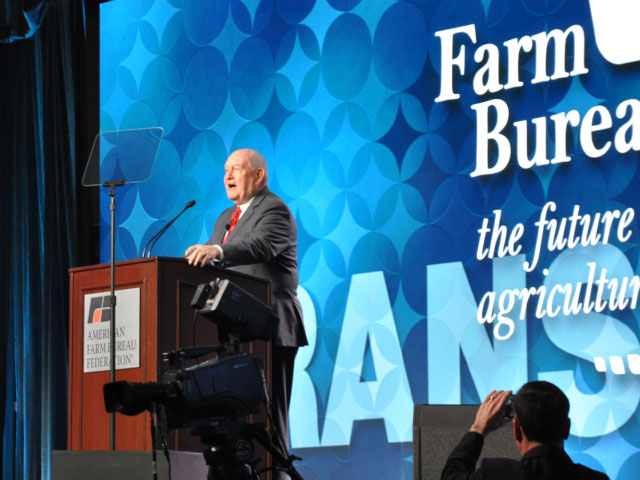 Agriculture Secretary Sonny Perdue speaking to the American Farm Bureau Federation in 2018. In this year's speech, Perdue highlighted NASS crop production data and his belief NASS is closer to correct than the market expected. (DTN file photo)
