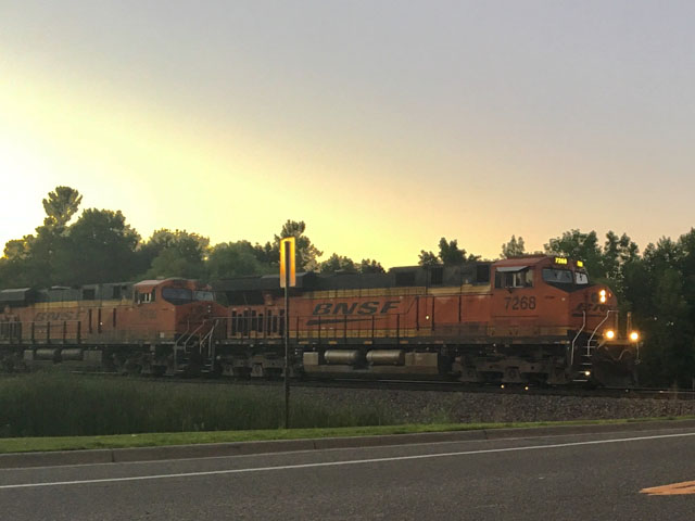 BNSF train moving east along the Northern Transcon at dusk. (Photo by Kelly Moshier, Maple Grove Minnesota)