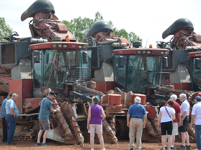 Farmers from the Midwest and Canada, along with their spouses, check out sugar-cane harvesters during a trip to a sugar refinery and ethanol plant in south-central Mato Grosso, Brazil in early February. (DTN photo by Chris Clayton)