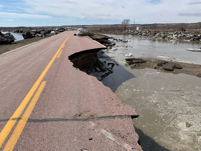A damaged road in northwest Nebraska following floods that hit the state in mid-March. Congress continues to work on a possible disaster package. (Photo courtesy of the Nebraska governor's office)