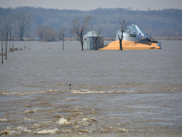 A busted grain bin and raging water on the Missouri River bottoms near Bartlett, Iowa, earlier this week. It's a repeated scene throughout the flooded areas along the Missouri River. (DTN photo by Chris Clayton)