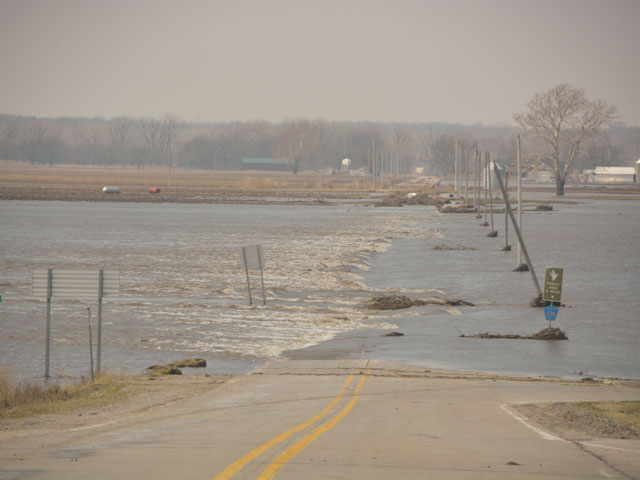 A flooded roadway off Interstate 29 last spring in southwest Iowa after heavy flooding along the Missouri River. Eight senators from states impacted by last year's flooding have introduced a bill requiring the Corps to reduce flood risks on the lower Missouri River. (DTN file photo by Chris Clayton)