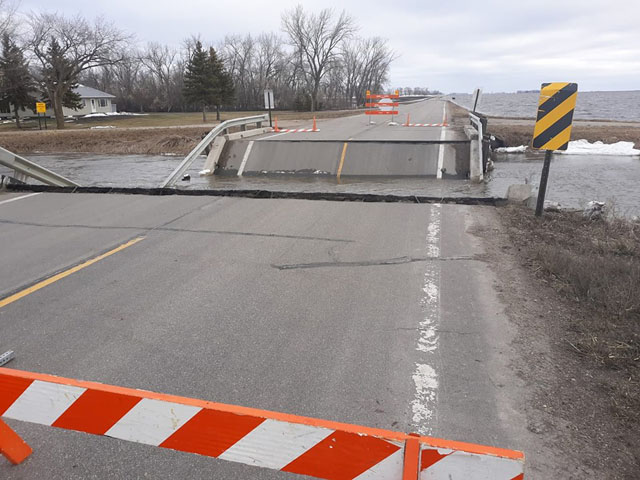 Pictured is a rural bridge crossing a flooded drainage ditch that collapsed due to ice and high water on County Hwy 18 in Norman County, west of Ada, Minnesota. (Photo by Norman County Sheriff's office)