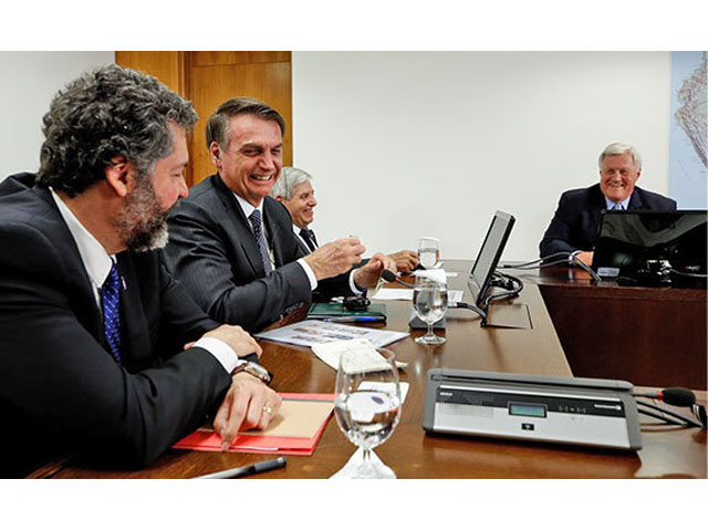 House Agriculture Committee Chairman Collin Peterson, D-Minn., right, meets with President Jair Bolsonaro of Brazil, second from left, on Friday. (Photo courtesy of the Office of Rep. Peterson)