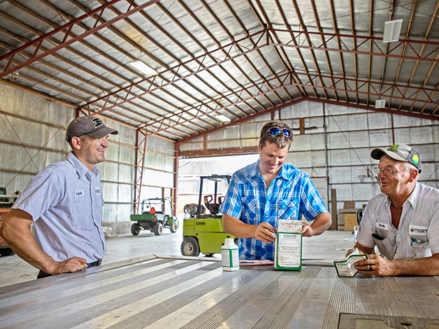 Managing employees, negotiating with vendors and digging into farm financials are just a few of the subjects Caleb Wilson (left) learned at The Executive Program for Agricultural Producers (TEPAP) last year. (DTN/Progressive Farmer photo by Jodi Miller)