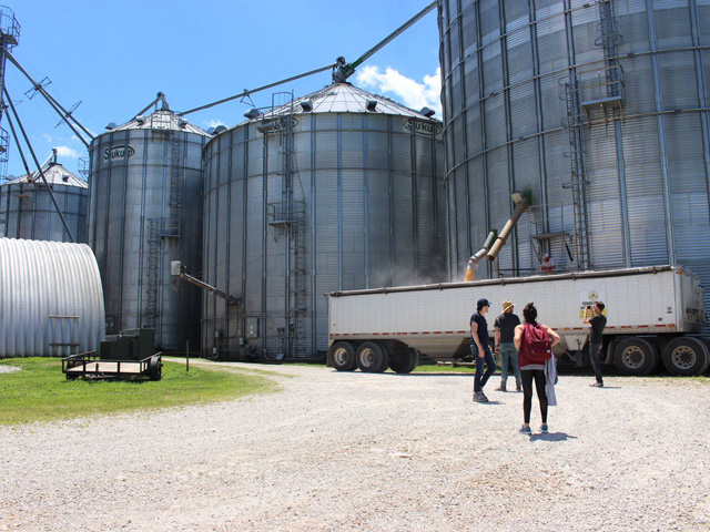 "Bins are as common as sunshine across the Grain Belt -- a modern miracle of grain handling or a fatal trap when safety is ignored. Here, ""SILO's"" crew is scouting a location. (Progressive Farmer photo by Dan Miller)"