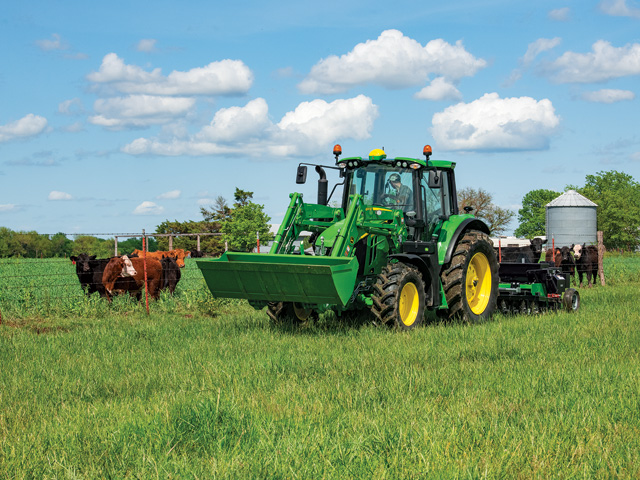 John Deere offers a handful of factory-installed technology options on its 6Ms, including StarFire 6000, AutoTrac and JDLink. Here, Deere's 6120M tractor is matched with the 600R loader. (Photo courtesy of John Deere)