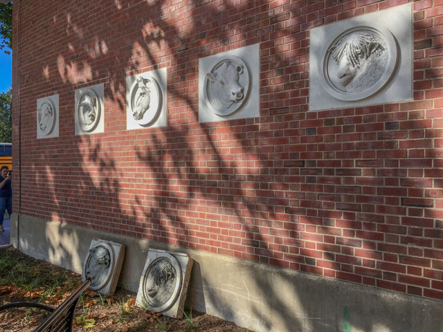 Five replicas of livestock-themed stone medallions now preside over the circa-1913 University of Illinois Stock Pavilion. Some originals are pictured below. (DTN photo by Pamela Smith)