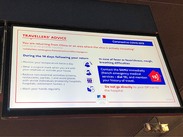 A sign in the Paris airport in early March cautioned travelers to watch for the signs of the coronavirus named COVID-19, especially if they are returning from China or other places where the virus is actively circulating. (DTN photo by Elaine Shein)