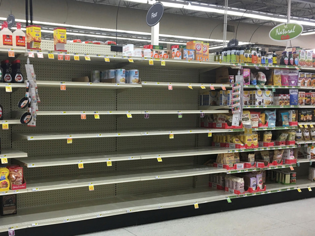 Empty shelves where flour would normally be are becoming the norm at many supermarkets across the U.S. as consumers prepare for a worst-case scenario where fresh bread may hard to source as the coronavirus continues to spread. (Photo by Kelly Moshier)