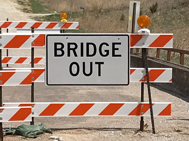 "With meat packing plants shut down due to coronavirus outbreaks, an important ""bridge"" between livestock producers and consumers has been closed. (DTN photo by Rick Kment)"