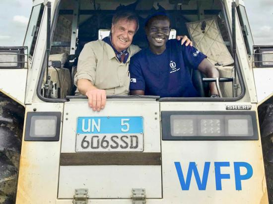 Ambassador Kip Tom works with a representative of the United Nations World Food Programme. (Photo courtesy of Kip Tom)