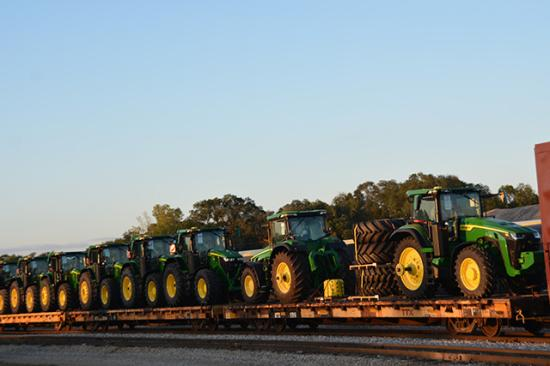 A line of tractors on rail cars outside the Deere & Co. plant in Waterloo, Iowa, earlier this week. Production at Deere's 14 U.S. facilities could shut down with the United Auto Workers International announcing early Thursday that its 10,000-plus members will go on strike following failed negotiations with Deere on a new contract. (DTN photo by Chris Clayton)