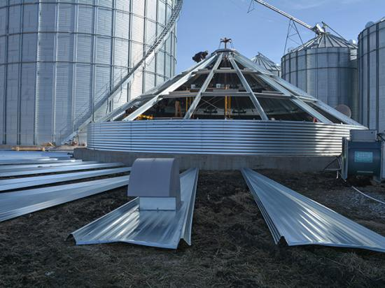 Employees of C&S Construction Grain Bin Services of Higginsville, Missouri, build a grain bin on the Stalzer family farm near Haverhill, Iowa. The bin replaces one destroyed in last year's derecho that struck the Midwest. (DTN photo by Matthew Wilde)