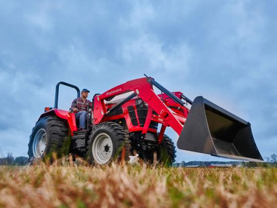 Mahindra's new 5100 series comes with four-wheel drive, 12x12 transmission, three-point hitch with flexible links, 3,100 pounds of lifting power and a front loader with a lift height of 122 inches. (Photo courtesy of Mahindra Ag North America)