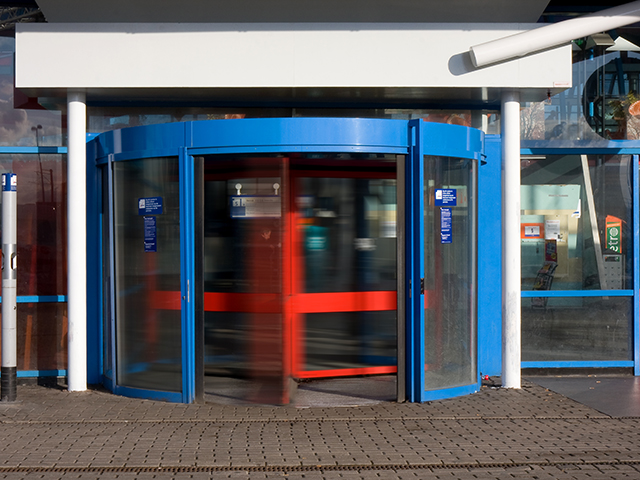 A revolving door of short-term employees probably indicates you need a more formal orientation process. (Photo by by Marcel Oosterwijk; CC BY-SA 2.0)