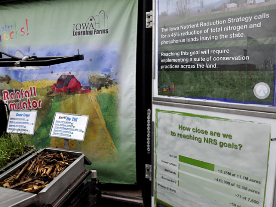 A rain simulator with details on Iowa's nutrient reduction strategy was part of the display outside the Iowa State University building at the Farm Progress Show near Boone, Iowa on Tuesday. (DTN photo by Chris Clayton)