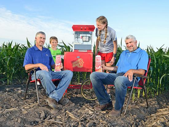Popcorn is a family enterprise for Paul (left) and Mark McHargue. The Central City, Nebraska, brothers and Paul's children, Trev and Jada, enjoy some homegrown goodness. (Progressive Farmer photo by Jim Patrico)
