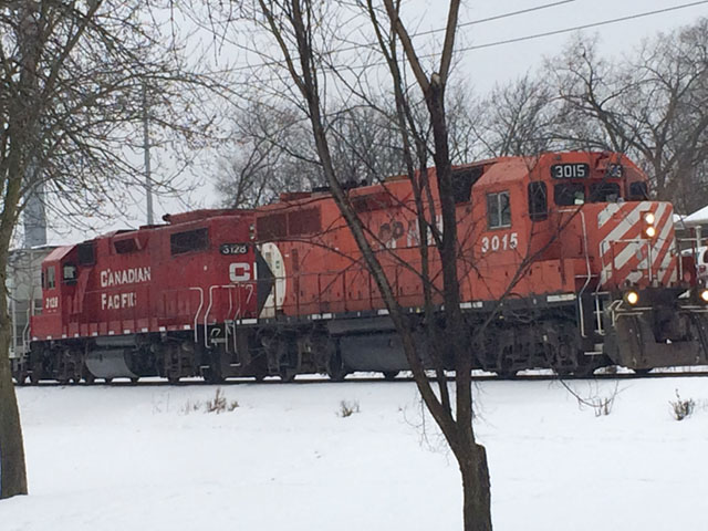 A Canadian Pacific freight train heads through St. Louis Park, Minnesota, on the Twin Cites Line. The CP, along with all U.S. Class 1 Railroads, were asked to update the U.S. Surface Transportation Board on current and upcoming service plans after shippers complained that some railroads had fallen behind during the first quarter of 2018. (DTN photo by Mary Kennedy)