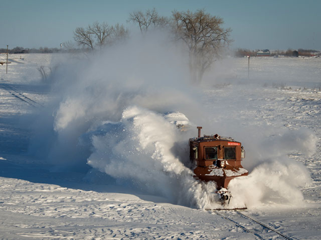 BNSF snow dozer (there's a locomotive pushing it behind that cloud of snow) clearing rail tracks of snow in the Jamestown, North Dakota, Subdivision in mid-January 2017. BNSF employees have been handling heavy snowfall along parts of their network in the north since late November, 2016. (Photo courtesy of the BNSF Railway)