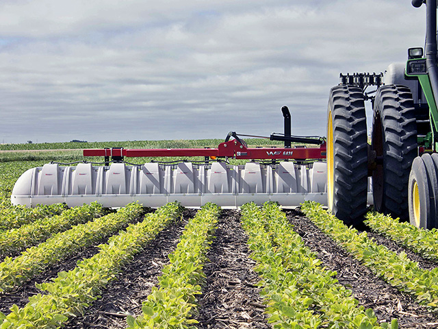The 642E hooded spray rig attaches to a tractor's three-point hitch and folds in the center. It comes in 30- and 40-foot-wide models. (Progressive Farmer photo courtesy of the manufacturer)