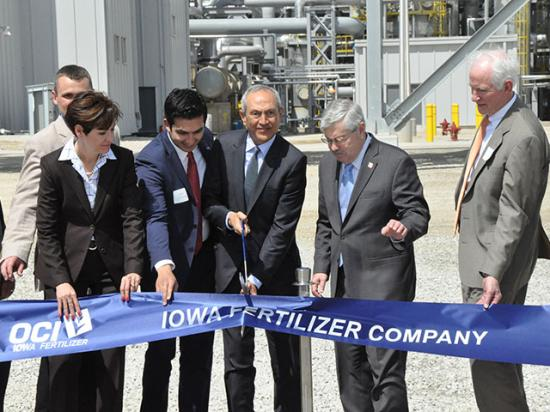 Nassef Sawiris, CEO of OCI N.V., (center, holding scissors) cuts the ribbon officially opening the Iowa Fertilizer Company nitrogen facility near Wever, Iowa, on Wednesday. The plant is the first newly constructed nitrogen-producing facility in the U.S. in 25 years. (DTN photo by Russ Quinn)