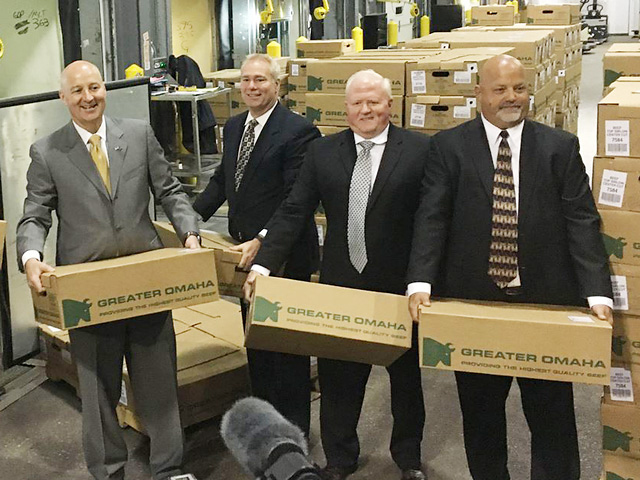 Nebraska Gov. Pete Ricketts and staff loading boxes of beef. (Photo courtesy of the Nebraska governor's office)