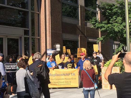 A couple dozen protesters demanding major labor-law changes to NAFTA stood outside a hearing Tuesday in Washington. (DTN photo by Chris Clayton)