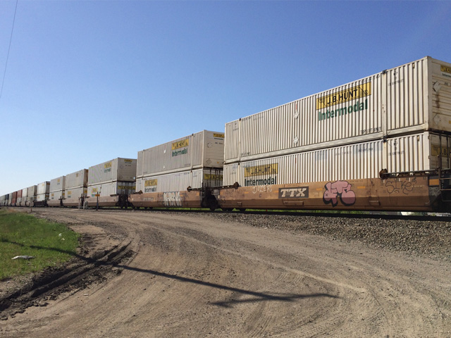 The International Longshore and Warehouse Union (ILWU) contract extension with the Pacific Maritime Association, which represents the West Coast interests, is good news for ag shippers. The shippers lost money and customers in past labor disputes because of the slowdowns severely affecting their shipments, such as these containers at Fargo, North Dakota. (DTN photo by Mary Kennedy)