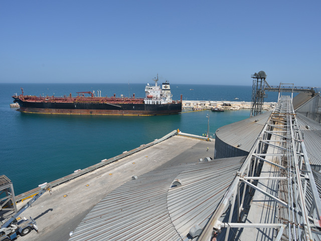 The Grupo Logra grain terminal at Puerto de Progreso, Mexico, offloads 2.1 million metric tons of grain annually, most from U.S. producers. The port also serves oil tankers such as the one docked here. (DTN/The Progressive Farmer photo by Jim Patrico)