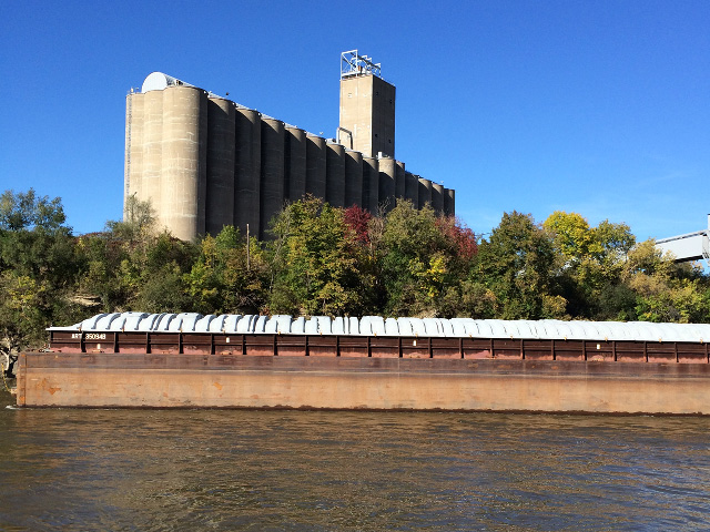 An empty barge sits docked at a river terminal on the Mississippi River west of downtown St. Paul, Minnesota. As harvest progresses and barges are loaded to head south, they will face low-water obstacles and lock repairs along their journey. The river level at St. Paul was at 5 feet above zero gauge on Oct. 2. (DTN photo by Mary Kennedy)