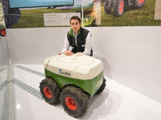 Swarms of mini-robot planters could one day put corn in the ground. Thiemo Buchner, Fendt project developer for robots, displayed a Xaver robot at Agritechnica. Plans are to have the robots in production and for sale in two years. (DTN/The Progressive Farmer photo by Jim Patrico)