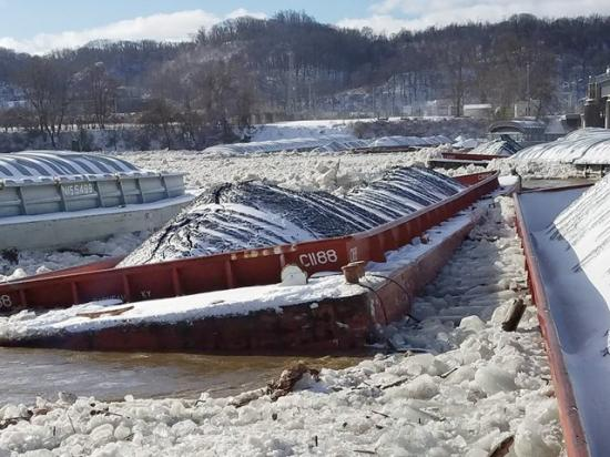 27 or more breakaway barges were lodged at Emsworth Lock and Dam on the Ohio River near Pittsburgh on January 13, closing the river and increasing the risk of localized flooding in the Pittsburgh pool according to the USACE. (Photo courtesy of USACE)