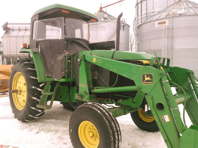 """Farmer Lyn Wessel of southern Minnesota utilizes a slightly altered heat houser on his 1998 John Deere 7405 open station tractor. He pushes snow with this tractor with the help a loader and blower as well as """"$400 of Carhart and UnderArmour products and I'm good to -20 F."""" (Photo courtesy of Lyn Wessel)"""