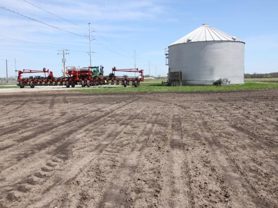 Planters across the country are stalled, as farmers wait for warmer, drier weather to plant corn. (DTN photo by Pamela Smith)