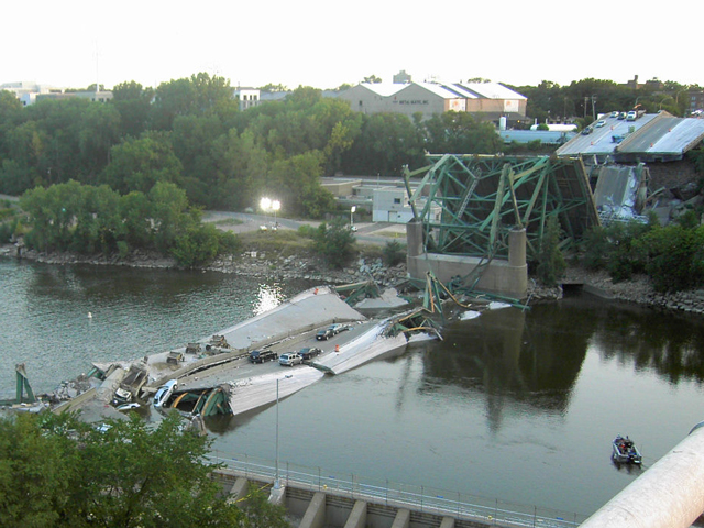On a bright, sunny evening August 1, 2007, the I-35W Bridge in downtown Minneapolis collapsed during rush hour, killing 13 people and injuring 145. Pictured is the scene on the first morning after its collapse. (Photo courtesy of Mike Wills, via Wikipedia)
