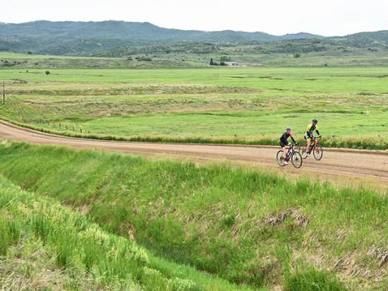Biking enthusiasts enjoy the rural landscape on dirt roads during the annual Moots Colorado Ranch Rally. (Progressive Farmer photo by Joel Reichenberger)